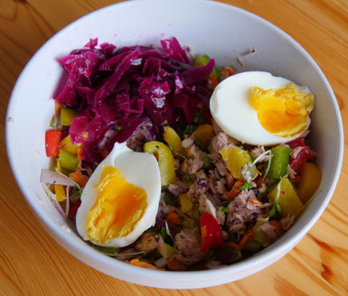 A delicious, healthy and tasty meal: tuna salad, a boiled egg and some fermented pickled red cabbage