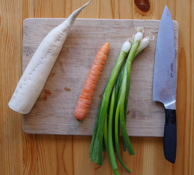 Mooli (also known as daikon) carrot and spring onions