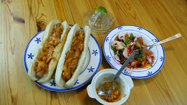 Hotdogs with kimchi and salad